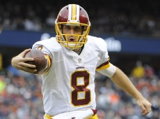 CHICAGO, IL- DECEMBER 13:  Kirk Cousins #8 of the Washington Redskins scores a touchdown during the first quarter against the Chicago Bears on December 13, 2015 at Soldier Field in Chicago, Illinois.  (Photo by David Banks/Getty Images)