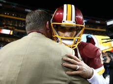 LANDOVER, MD - JANUARY 10:  Quarterback Kirk Cousins #8 of the Washington Redskins embraces general manager Scot McCloughan after the Green Bay Packers defeated the Washington Redskins 35-18 during the NFC Wild Card Playoff game at FedExField on January 10, 2016 in Landover, Maryland. (Photo by Patrick Smith/Getty Images)