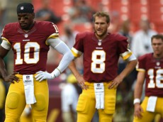 LANDOVER, MD - AUGUST 07: Quarterback Robert Griffin III #10, quarterback Kirk Cousins #8, and quarterback Colt McCoy #16 of the Washington Redskins look on before playing the New England Patriots during their preseason NFL game at FedExField on August 7, 2014 in Landover, Maryland. (Photo by Patrick Smith/Getty Images)