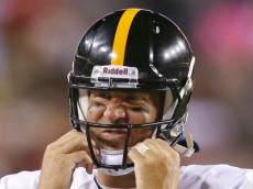 LANDOVER, MD - AUGUST 19: Quarterback Ben Roethlisberger #7 of the Pittsburgh Steelers adjusts his helmet during the first half of a preseason game against the Washington Redskins at FedExField on August 19, 2013 in Landover, Maryland.  (Photo by Rob Carr/Getty Images)