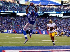 EAST RUTHERFORD, NJ - DECEMBER 14:  Odell Beckham Jr. #13 of the New York Giants attempts to score a 30 yard touchdown that was nullified due to a penalty in the fourth quarter during their game against the Washington Redskins at MetLife Stadium on December 14, 2014 in East Rutherford, New Jersey.  (Photo by Al Bello/Getty Images)