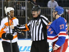 Mar 26, 2014; New York, NY, USA;   Referee separates Philadelphia Flyers right wing Wayne Simmonds (17) and New York Rangers defenseman Ryan McDonagh (27) during the third period at Madison Square Garden. New York Rangers won 3-1.  Mandatory Credit: Anthony Gruppuso-USA TODAY Sports