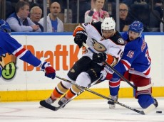 Mar 22, 2015; New York, NY, USA; Anaheim Ducks right wing Emerson Etem (16) battles for the puck with New York Rangers center Derick Brassard (16) during the first period at Madison Square Garden. Mandatory Credit: Adam Hunger-USA TODAY Sports