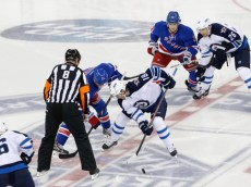 Dec 2, 2013; New York, NY, USA;  Winnipeg Jets center Bryan Little (18) wins the face off from New York Rangers center Derek Stepan (21) during the first period at Madison Square Garden. Mandatory Credit: Anthony Gruppuso-USA TODAY Sports