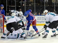 Mar 16, 2014; New York, NY, USA; San Jose Sharks goalie Antti Niemi (31) makes a save against New York Rangers center Dominic Moore (28) during the second period of a game at Madison Square Garden. Mandatory Credit: Brad Penner-USA TODAY Sports