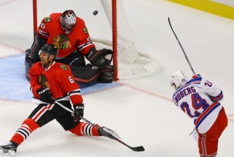Oct 7, 2015; Chicago, IL, USA; New York Rangers center Oscar Lindberg (24) scores a goal past Chicago Blackhawks goalie Corey Crawford (50) and defenseman Trevor Daley (6) in the first period at United Center. Mandatory Credit: Jerry Lai-USA TODAY Sports