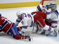 Oct 15, 2015; Montreal, Quebec, CAN; New York Rangers defenseman Ryan McDonagh (27) moves Montreal Canadiens forward Brendan Gallagher (11) away from teammate goalie Henrik Lundqvist (30)during the first period at the Bell Centre. Mandatory Credit: Eric Bolte-USA TODAY Sports