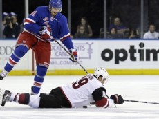 Oct 22, 2015; New York, NY, USA; New York Rangers left wing Rick Nash (61) knocks the puck under Arizona Coyotes right wing Shane Doan (19) during the first period of an NHL hockey game at Madison Square Garden. Mandatory Credit: Adam Hunger-USA TODAY Sports
