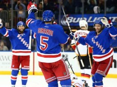Oct 25, 2015; New York, NY, USA; New York Rangers defenseman Dan Girardi (5) celebrates with his teammates after scoring a second period goal against the Calgary Flames at Madison Square Garden. Mandatory Credit: Andy Marlin-USA TODAY Sports