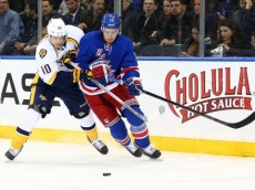 Mar 2, 2015; New York, NY, USA; New York Rangers right wing Kevin Hayes (13) and Nashville Predators center Mike Santorelli (10) fight for the puck during the first period at Madison Square Garden. Mandatory Credit: Brad Penner-USA TODAY Sports