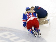 May 22, 2014; New York, NY, USA; New York Rangers center Derek Stepan (21) is checked on by a trainer after being knocked to the ice by the Montreal Canadiens during the first period in game three of the Eastern Conference Final of the 2014 Stanley Cup Playoffs at Madison Square Garden. Mandatory Credit: Andy Marlin-USA TODAY Sports ORG XMIT: USATSI-180984 ORIG FILE ID:  20140522_jla_bm4_064.jpg