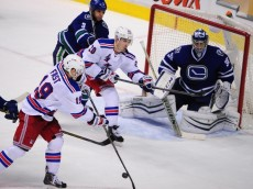 Dec 13, 2014; Vancouver, British Columbia, CAN; New York Rangers forward Jesper Fast (19) and forward Chris Kreider (20) move the puck in front of Vancouver Canucks goaltender Ryan Miller (30) during the third period at Rogers Arena. The New York Rangers won 5-1. Mandatory Credit: Anne-Marie Sorvin-USA TODAY Sports