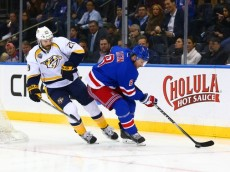 Nov 23, 2015; New York, NY, USA; Nashville Predators center Paul Gaustad (28) pursues New York Rangers defenseman Kevin Klein (8) as he plays the puck during the first period at Madison Square Garden. The Rangers defeated the Predators 3-0. Mandatory Credit: Andy Marlin-USA TODAY Sports