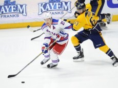 Dec 28, 2015; Nashville, TN, USA; New York Rangers center Derek Stepan (21) skates away from Nashville Predators center Mike Ribeiro (63) during the first period at Bridgestone Arena. Mandatory Credit: Christopher Hanewinckel-USA TODAY Sports