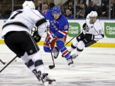 Feb 12, 2016; New York, NY, USA; New York Rangers center J.T. Miller (10) controls the puck in front of Los Angeles Kings center Anze Kopitar (11) during the first period at Madison Square Garden. Mandatory Credit: Adam Hunger-USA TODAY Sports