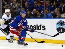 Apr 16, 2015; New York, NY, USA; New York Rangers defenseman Ryan McDonagh (27) plays the puck in front of Pittsburgh Penguins right wing Patric Hornqvist (72) during the third period of game one of the first round of the the 2015 Stanley Cup Playoffs at Madison Square Garden. The Rangers defeated the Penguins 2-1 to take a 1-0 lead in the series. Mandatory Credit: Brad Penner-USA TODAY Sports