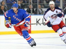 Feb 29, 2016; New York, NY, USA; New York Rangers center Eric Staal (12) skates in front of Columbus Blue Jackets center Brandon Dubinsky (17) during the first period at Madison Square Garden. Mandatory Credit: Brad Penner-USA TODAY Sports