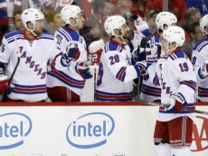 Mar 4, 2016; Washington, DC, USA; New York Rangers right wing Jesper Fast (19) celebrates with teammates after scoring a goal against the Washington Capitals in the first period at Verizon Center. Mandatory Credit: Geoff Burke-USA TODAY Sports