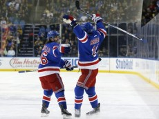 Mar 8, 2016; Buffalo, NY, USA; New York Rangers center Derick Brassard (16) celebrates his goal against the Buffalo Sabres with right wing Mats Zuccarello (36) during the first period at First Niagara Center. Mandatory Credit: Kevin Hoffman-USA TODAY Sports