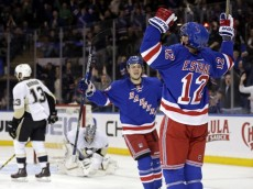 Mar 27, 2016; New York, NY, USA; New York Rangers center Eric Staal (12) celebrates with right wing Jesper Fast (19) after scoring a goal past Pittsburgh Penguins goalie Marc-Andre Fleury (29) during the second period at Madison Square Garden. Mandatory Credit: Adam Hunger-USA TODAY Sports
