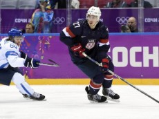 Feb 22, 2014; Sochi, RUSSIA; USA defenseman Ryan McDonagh (27) controls the puck against Finland forward Mikael Granlund (64) in the men's ice hockey bronze medal game during the Sochi 2014 Olympic Winter Games at Bolshoy Ice Dome. Mandatory Credit: Scott Rovak-USA TODAY Sports