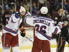 Jan 7, 2015; Anaheim, CA, USA; New York Rangers right wing Mats Zuccarello (36) celebrates with center Derick Brassard (left) after scoring a goal against the Anaheim Ducks during the third period at Honda Center. The New York Rangers won 4-1. Mandatory Credit: Kelvin Kuo-USA TODAY Sports