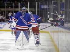 Apr 2, 2016; New York, NY, USA; New York Rangers goalie Henrik Lundqvist (30) reacts after being replaced by goalie Antti Raanta (32) during the second period against the Buffalo Sabres at Madison Square Garden. Mandatory Credit: Adam Hunger-USA TODAY Sports