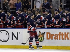 Apr 9, 2016; New York, NY, USA; New York Rangers defenseman Dan Boyle (22) celebrates with teammates after scoring a goal against the Detroit Red Wings during the first period at Madison Square Garden. Mandatory Credit: Adam Hunger-USA TODAY Sports