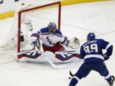 May 22, 2015; Tampa, FL, USA; New York Rangers goalie Henrik Lundqvist (30) makes a save against Tampa Bay Lightning defenseman Nikita Nesterov (89) in the second period in game four of the Eastern Conference Final of the 2015 Stanley Cup Playoffs at Amalie Arena. Mandatory Credit: Reinhold Matay-USA TODAY Sports