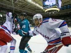 Mar 19, 2016; San Jose, CA, USA; San Jose Sharks right wing Melker Karlsson (68) and New York Rangers defenseman Dan Girardi (5) collide in the 2nd period  at SAP Center at San Jose. Mandatory Credit: John Hefti-USA TODAY Sports.