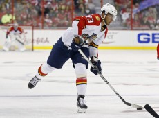 Oct 18, 2014; Washington, DC, USA; Florida Panthers center Brandon Pirri (73) shoots the puck against the Washington Capitals at Verizon Center. Mandatory Credit: Geoff Burke-USA TODAY Sports