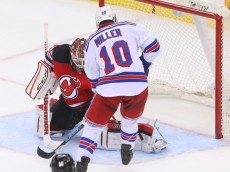 Feb 2, 2016; Newark, NJ, USA; New Jersey Devils goalie Cory Schneider (35) makes a save on New York Rangers center J.T. Miller (10) during the third period at Prudential Center. The Devils defeated the Rangers 3-2.  Mandatory Credit: Ed Mulholland-USA TODAY Sports