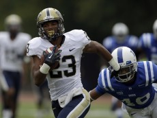 Duke's Dwayne Norman chases Pittsburgh's Tyler Boyd (23) during the first half of an NCAA college football game in Durham, N.C., Saturday, Sept. 21, 2013. (AP Photo/Gerry Broome)