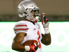Sep 7, 2015; Blacksburg, VA, USA; Ohio State Buckeyes wide receiver Braxton Miller (1) gestures to the crowd while running with the ball enroute to scoring a touchdown against the Virginia Tech Hokies in the third quarter at Lane Stadium. Mandatory Credit: Geoff Burke-USA TODAY Sports