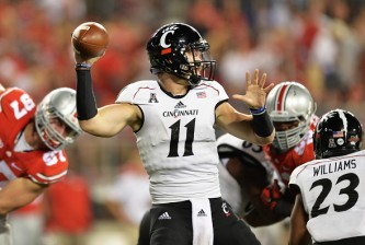 COLUMBUS, OH - SEPTEMBER 27:  Quarterback Gunner Kiel #11 of the Cincinnati Bearcats throws a 78-yard touchdown pass in the third quarter against the Ohio State Buckeyes at Ohio Stadium on September 27, 2014 in Columbus, Ohio. Ohio State defeated Cincinnati 50-28.   (Photo by Jamie Sabau/Getty Images)