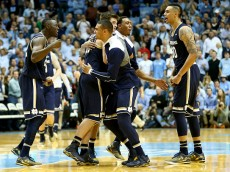 CHAPEL HILL, NC - JANUARY 05:  The Notre Dame Fighting Irish celebrate after defeating the North Carolina Tar Heels 71-70 at Dean Smith Center on January 5, 2015 in Chapel Hill, North Carolina.  (Photo by Streeter Lecka/Getty Images)
