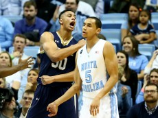 CHAPEL HILL, NC - JANUARY 05:  Zach Auguste #30 of the Notre Dame Fighting Irish reacts as Marcus Paige #5 of the North Carolina Tar Heels watches on during their game at Dean Smith Center on January 5, 2015 in Chapel Hill, North Carolina.  (Photo by Streeter Lecka/Getty Images)
