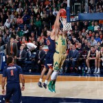 SOUTH BEND, IN - JANUARY 10: Anthony Gill #13 of the Virginia Cavaliers blocks a dunk attempt by Zach Auguste #30 of the Notre Dame Fighting Irish in the first half of the game at Purcell Pavilion on January 10, 2015 in South Bend, Indiana. Virginia defeated Notre Dame 62-56. (Photo by Joe Robbins/Getty Images)