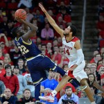 RALEIGH, NC - JANUARY 25:  Jerian Grant #22 of the Notre Dame Fighting Irish shoots over Caleb Martin #14 of the North Carolina State Wolfpack during their game at PNC Arena on January 25, 2015 in Raleigh, North Carolina.  (Photo by Grant Halverson/Getty Images)