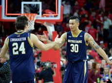 RALEIGH, NC - JANUARY 25:  Pat Connaughton #24 and Zach Auguste #30 of the Notre Dame Fighting Irish celebrate after a win against the North Carolina State Wolfpack at PNC Arena on January 25, 2015 in Raleigh, North Carolina. Notre Dame won 81-78 in overtime.  (Photo by Grant Halverson/Getty Images)