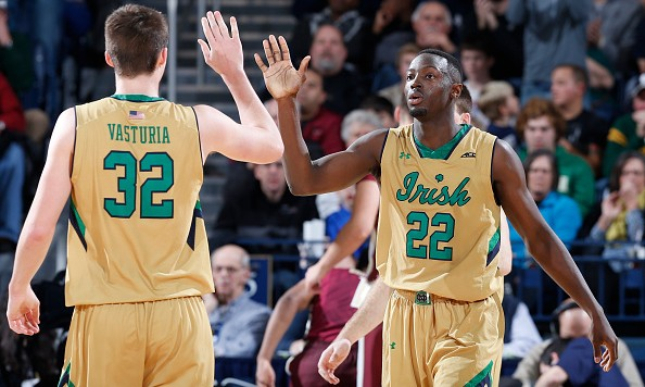 SOUTH BEND, IN - DECEMBER 13: Jerian Grant #22 of the Notre Dame Fighting Irish is congratulated by Steve Vasturia #32 after scoring a basket against the Florida State Seminoles during the game at Purcell Pavilion on December 13, 2014 in South Bend, Indiana. Notre Dame defeated Florida State 83-63. (Photo by Joe Robbins/Getty Images)