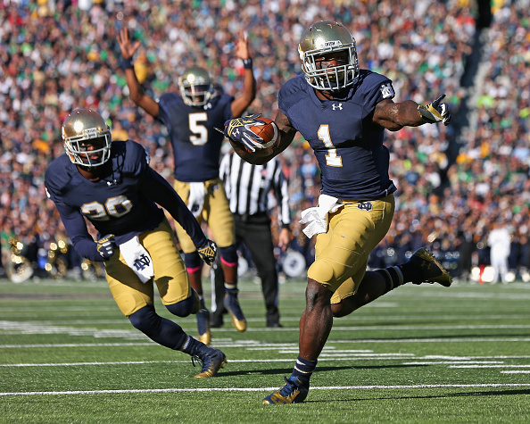 SOUTH BEND, IN - OCTOBER 11: Greg Bryant #1 of the Notre Dame Fighting Irish runs for a touchdown in front of C.J. Prosise #20 as Evertt Golson #5 signals the score against the North Carolina Tar Heels at Notre Dame Stadium on October 11, 2014 in South Bend, Indiana. (Photo by Jonathan Daniel/Getty Images)