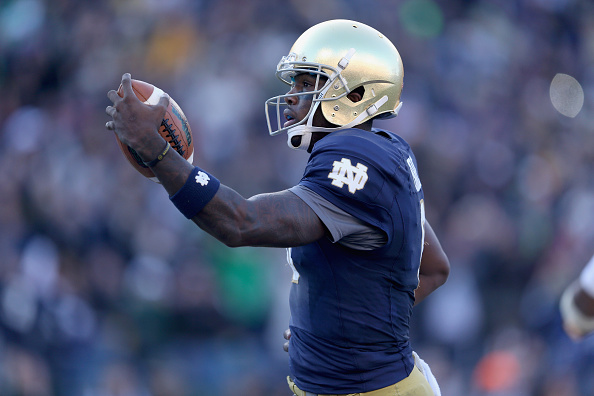 NASHVILLE, TN - DECEMBER 30:  Malik Zaire #8 of the Notre Dame Fighting Irish runs for a touchdown against the LSU Tigers during the Franklin American Mortgage Music City Bowl at LP Field on December 30, 2014 in Nashville, Tennessee.  (Photo by Andy Lyons/Getty Images)