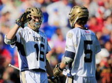 BALTIMORE, MD - MAY 24: Sergio Perkovic #16 of the Notre Dame Fighting Irish celebrates with teammate Jim Marlatt #5 after scoring a second half goal against the Maryland Terrapins during the semifinals of the 2014 NCAA Division I Men's Lacrosse Championship at M&T Bank Stadium on May 24, 2014 in Baltimore, Maryland.  (Photo by Rob Carr/Getty Images)