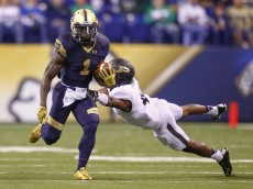 INDIANAPOLIS, IN - SEPTEMBER 13: Greg Bryant #1 of the Notre Dame Fighting Irish runs the ball as Taylor Richards #4 of the Purdue Boilermakers lunges for the tackle at Lucas Oil Stadium on September 13, 2014 in Indianapolis, Indiana.  (Photo by Michael Hickey/Getty Images)