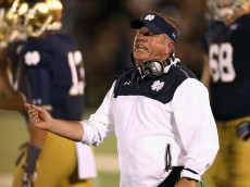 SOUTH BEND, IN - SEPTEMBER 06:  Head coach Brian Kelly of the Notre Dame Fighting Irish yells at a player during a game against the Michigan Wolverines at Notre Dame Stadium on September 6, 2014 in South Bend, Indiana.  (Photo by Jonathan Daniel/Getty Images)