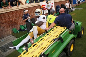 CHARLOTTESVILLE, VA - SEPTEMBER 12: Quarterback Malik Zaire #8 of the Notre Dame Fighting Irish is carted off of the field after being injured against the Virginia Cavaliers in the third quarter at Scott Stadium on September 12, 2015 in Charlottesville, Virginia. The Notre Dame Fighting Irish won, 34-27. (Photo by Patrick Smith/Getty Images)