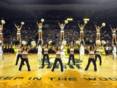 EUGENE, OR - JANUARY 13: The Oregon Cheerleaders entertain during the pre-game ceremonies before the first game between the USC Trojans and the Oregon Ducks basketball teams at Matt Court on January 13, 2011 in Eugene, Oregon. The arena is named  co-founder and Chairman of Nike, Inc., Phil Knight's son, Matthew, who died at the age of 34 in a scuba diving accident. (Photo by Steve Dykes/Getty Images)