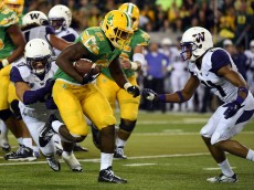 EUGENE,OR - OCTOBER 18: Running back Royce Freeman #21 of the Oregon Ducks  runs with the ball during the fourth quarter of the game against the Washington Huskies at Autzen Stadium on October 18, 2014 in Eugene, Oregon. Oregon won the game 45-20. (Photo by Steve Dykes/Getty Images)