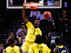 NEW YORK, NY - NOVEMBER 24: Jordan Bell #1 of the Oregon Ducks dunks in the first half during a game against the Michigan Wolverines at the Barclays Center on November 24, 2014 in the Brooklyn borough of New York City.  (Photo by Alex Goodlett/Getty Images)